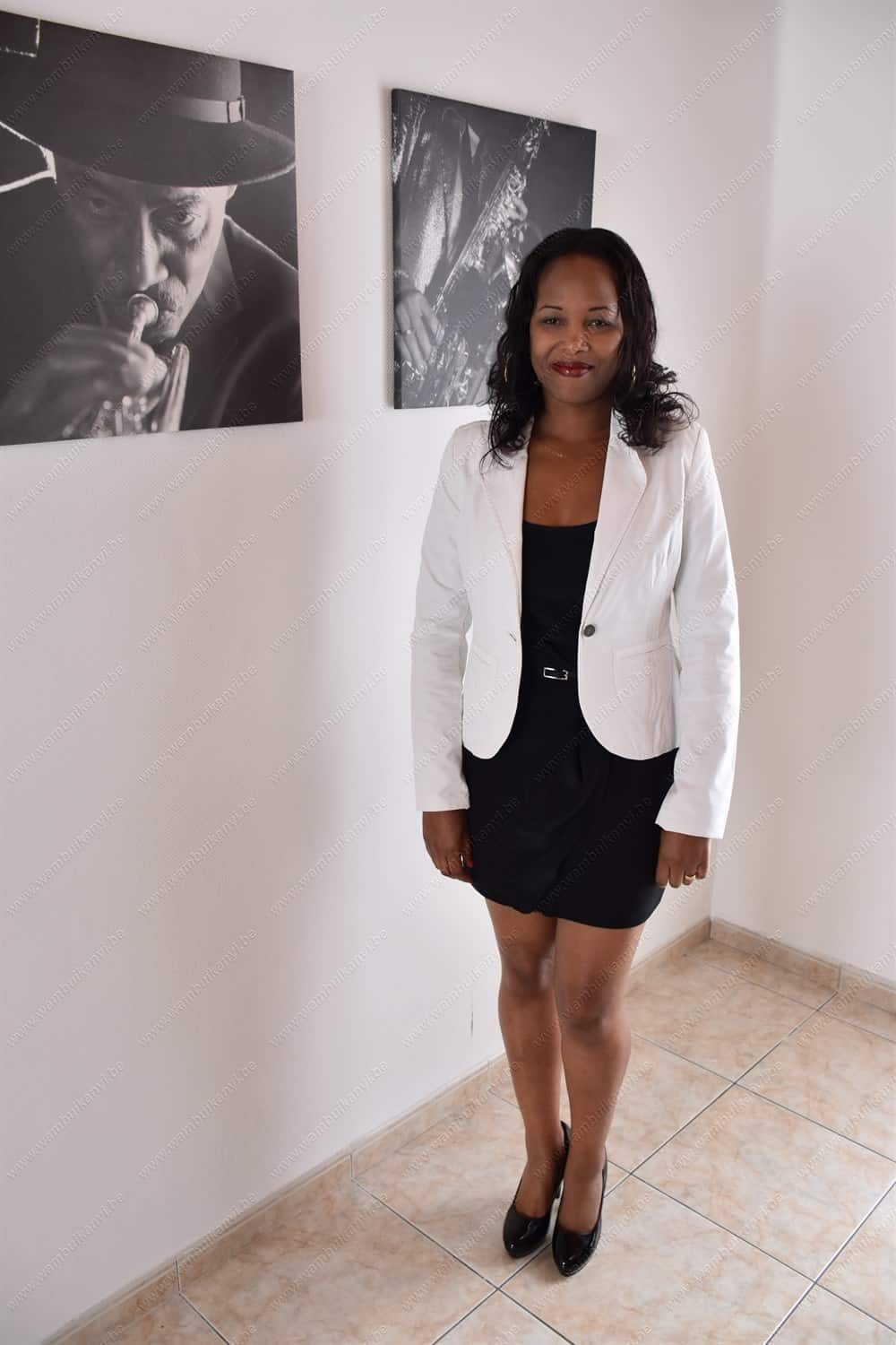 Complementing the look with a white blazer